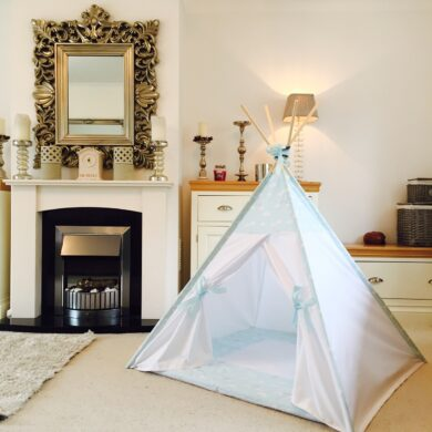 white teepee tent with pale blue clouds